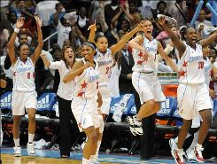 From left to right, the Dream's Iziane Castro Marques, Angel McCoughtry, Armintie Price, Coco Miller and Sancho Lyttle celebrate their sweep over the New York Liberty in the Eastern Conference finals Tuesday in Atlanta.