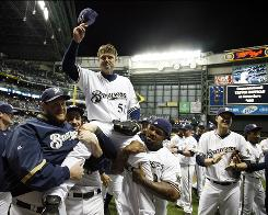 Closer Trevor Hoffman is carried off the field by Milwaukee teammates after earning his 600th career save as the Brewers clipped the Cardinals 4-2.