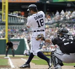 Tigers' Johnny Damon hits an RBI single against White Sox pitcher Gavin Floyd in the first inning.