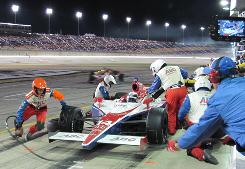 Vitor Meira gets quick service from his crew during an early race pit stop at Kentucky Speedway.