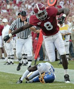 Playing on campus in Tuscaloosa last week, Alabama's Julio Jones picks up hardage after an acrobatic catch vs. San Jose State.