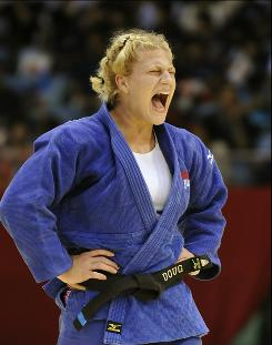 American Kayla Harrison reacts as she celebrates her win over Brazilian Mayra Aguiar during the women's 172-pound final at the world judo championships in Tokyo.