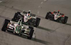 Tony Kanaan leads the Penske pair of Will Power and Helio Castroneves during Saturday's 300-miler at Kentucky Speedway.