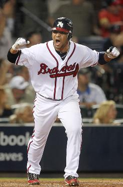 Atlanta shortstop Alex Gonzalez hit a three-run home in the 12th inning to beat the St. Louis Cardinals 6-3.