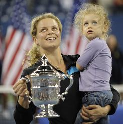 Kim Clijsters and daughter Jada celebrate a U.S. Open victory Saturday in New York, Clijsters' second in a row and third overall.