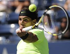 Top-seeded Rafael Nadal of Spain rifles a forehand during his straight-sets victory Saturday against Mikhail Youzhny of Russia at the U.S. Open in New York. Nadal advanced to the U.S. Open final for the first time.