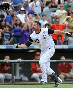 Colorado's Jason Giambi tosses his helmet after hitting a walk-off home run against the Arizona Diamondbacks in Denver.