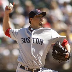 Red Sox pitcher Josh Beckett allowed three runs on five hits in six innings, struck out seven and walked five to win for the first time in three starts.