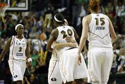 Storm forward Camille Little (20) hugs teammate Sue Bird after Bird's game-winning shot in the closing seconds of Game 1.