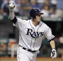 Reid Brignac raises his fist after hitting a walk-off homer in the bottom of the 11th to lead the Rays past the Yankees 1-0.
