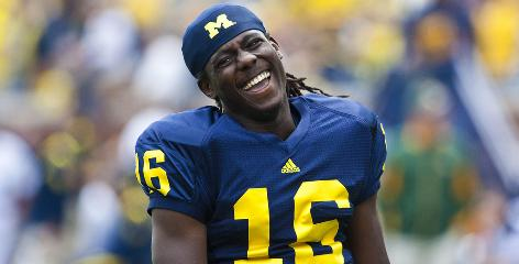 "Michigan sophomore quarterback Denard Robinson has thrust himself into the Heisman conversation with 455 rushing yards and 430 passing yards in wins over Connecticut and Notre Dame. Says Connecticut coach Randy Edsall: ""Denard Robinson is going to make people look bad."""