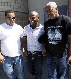 Floyd Mayweather, Jr. is escorted out of Clark County Detention Center in Las Vegas after posting the $3,000 bail. Mayweather faces a grand larceny charge stemming from a dispute with his ex-girlfriend.