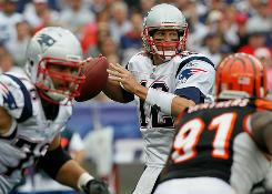 Tom Brady led the Patriots to a season-opening win days after signing a four-year contract extension.