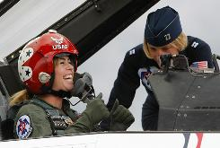 "Paula Creamer goes over the rules of the air with Kristin ""Mother"" Hubbard of the U.S. Air Force Thunderbirds last week at the Air Force Reserve Base in Pittsburgh. Creamer got a flyover of Oakmont Country Club, the site of her U.S. Women's Open victory in July."