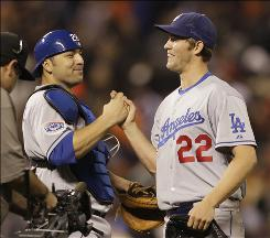 Dodgers starter Clayton Kershaw, right, is congratulated by catcher Rod Barajas after throwing a four-hit 1-0 shutout against the Giants.