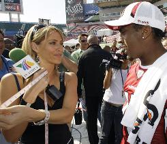 TV Azteca reporter Ines Sainz talks to Arizona Cardinals receiver Steve Breaston at the 2009 Super Bowl.