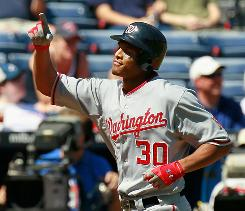 Nationals' Justin Maxwell reacts after hitting a grand slam in the second inning against the Braves.