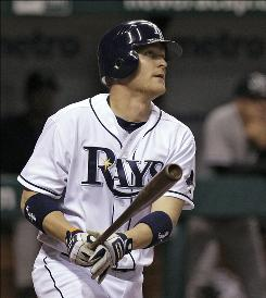 The Rays' Dan Johnson watches his two-run homer in the fifth inning off Yankees starter Phil Hughes. Johnson would hit another two-run bomb off Hughes in the seventh.