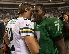 Eagles QB Michael Vick, right, may get his first start since 2006 if Kevin Kolb continues to deal with the effects of a concussion.