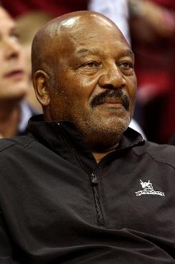 NFL Hall of Famer Jim Brown, shown here during a 2009 NBA playoff game in Cleveland, has said he won't attend the Cleveland Browns ring of honor ceremony Sunday honoring him and 15 other former Browns.