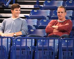 Eli Manning, left, and brother Peyton Manning will face off for just the second time in their careers on Sunday.