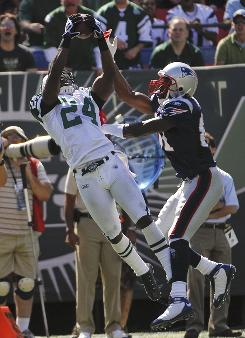 The matchup between Jets cornerback Darrelle Revis, left, and Patriots receiver Randy Moss (shown here during their first meeting of 2009) is one to watch when New England visits the Jets on Sunday (4:15 ET, CBS).