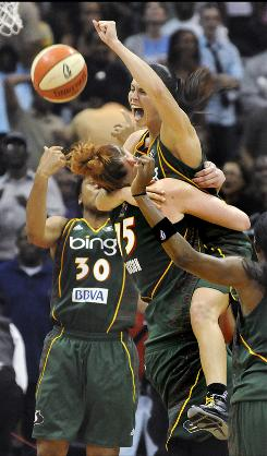 Guard Sue Bird, right, celebrates with Storm teammate Lauren Jackson after Seattle defeated the Atlanta Dream 87-84 in Game 3 of the WNBA Finals on Thursday. The Storm swept the series 3-0.