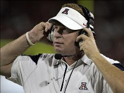 Coach Mike Stoops and his 18th-ranked Arizona Wildcats host No. 10 Iowa on Saturday.