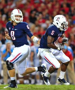 Arizona Wildcats running back Nic Grigsby, right, and quarterback Nick Foles combined for 321 yards and four touchdowns in last week's win over The Citadel.