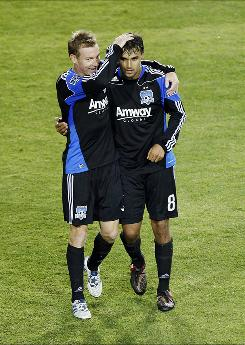 Bobby Convey, left,  congratulates Earthquakes teammate Chris Wondolowski after he scored the eventual game-winning goal against the Union.
