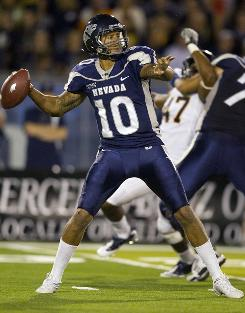 Nevada quarterback Colin Kaepernick, throwing a pass during the second quarter, threw for 183 yards and two scores and rushed for 142 yards and three touchdowns to lead the Wolf Pack over No. 24 Cal.