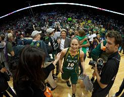 Seattle Storm guard Sue Bird (10) celebrates after her team defeated the Atlanta Dream to win the WNBA title, capping off a near-perfect season.