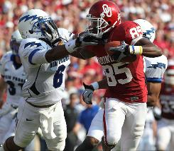 Oklahoma receiver Ryan Broyles fights off Air Force cornerback Jon Davis after a reception in the third quarter.