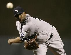 Yankees pitcher CC Sabathia deals in the first inning against the Orioles. The big lefty pitched seven innings and picked up his 20th win of the season.
