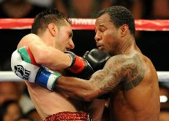 Sergio Mora, left, battles with Sugar Shane Mosley during their 12-round draw in Los Angeles.