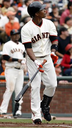 San Francisco outfielder Jose Guillen watches the flight of his grand slam off of Milwaukee Brewers pitcher Chris Narveson in the first inning. The Giants won 9-2.