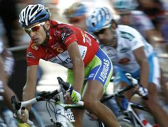 Italian rider Vincenzo Nibali of Liquigas-Doimo, left, and Spanish rider Ezequiel Mosquera of Xacobeo Galicia ride during the last stage of the Spanish Vuelta in Madrid.