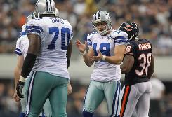 Cowboys kicker David Buehler reacts after missing a field goal in Sunday's loss to the Bears.