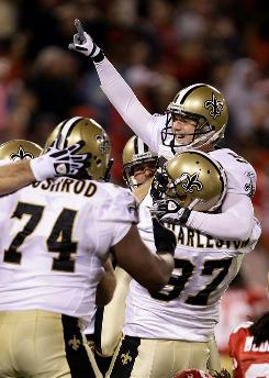 Garrett Hartley, top right, and the Saints celebrate Hartley's game-winning 37-yard field goal to beat the 49ers. Hartley's boot moved New Orleans to 2-0 in consecutive seasons for the first time in team history.