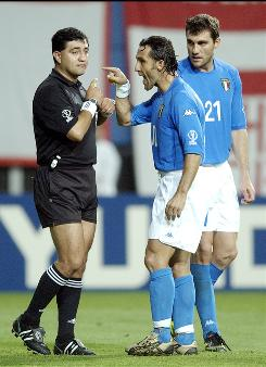 Byron Moreno, the controversial 2002 World Cup referee, was caught at Kennedy Airport with bags of heroin attached to his body Tuesday. This June 18, 2002 photo shows Italy's Angelo Di Livio arguing with Moreno, left, after he showed a red card to Francesco Totti during a game against South Korea at the 2002 World Cup in Daejeon, South Korea.