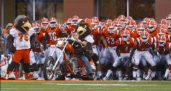 Students at Bowling Green State University in Ohio, whose football team is shown before its game against Marshall on Sept. 18, approved a $60-per-semester fee to help finance construction of a new campus arena/convocation center. The building is scheduled to be completed in 2011.