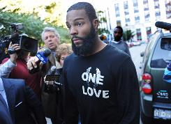 Jets receiver Braylon Edwards leaves court after being arrested on Tuesday.
