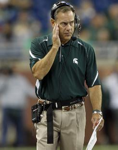 Michigan State coach Mark Dantonio, watching the Spartans take on Florida Atlantic on Sept. 11, suffered a heart attack after his team defeated Notre Dame on Saturday.