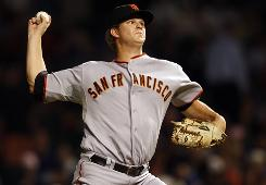 Giants starter Matt Cain, along with a steady bullpen, combined for a two-hitter to defeat the Cubs, 1-0, Tuesday night.