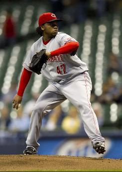 Reds starting pitcher Johnny Cueto throws a pitch during the first inning against the Brewers. Cueto didn't get out of the second inning after Milwaukee tagged him for eight earned runs.