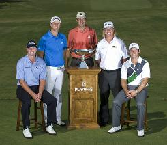 The top five players in the FedExCup standings pose with the FedExCup on the first tee during practice for The Tour Championship. The five, left to right: Steve Stricker, Dustin Johnson, Matt Kuchar, Charley Hoffman and Paul Casey.