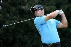 Paul Casey of England raps his tee shot on the fifth hole during the first round of The Tour Championship Thursday at East Lake Golf Club. Casey opened with a 4-under 66 to take a share of the lead.