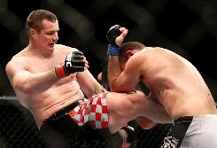 "Mirko ""Cro Cop"" Filipovic, left, will battle Frank Mir in the headliner match of UFC 119. Besides Mir, Filipovic will have to fight through an eye injury suffered during training."