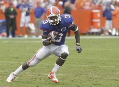 Florida receiver Chris Rainey, running against Troy during a Sept. 12, 2009 game, was booked last week on a felony charge of aggravated stalking.