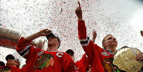 Stars Jonathan Toews and Patrick Kane acknowledge the crowd at a Chicago parade celebrating the Blackhawks' first Stanley Cup title since 1961.